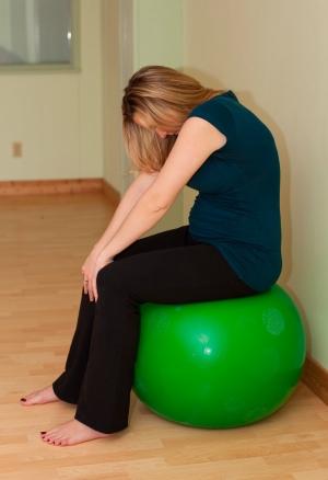 Pelvic tilt on ball prenatal yoga concave